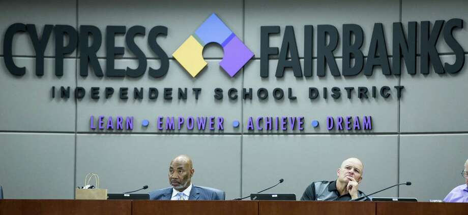 Dr. John Ogletree, Jr., board president, left, and Dr. Mark Henry, superintendent, listen to the budget presentation during the Cypress-Fairbanks ISD school board of trustees meeting on Thursday, June 14, 2018, in Cypress. ( Brett Coomer / Houston Chronicle ) Photo: Brett Coomer, Staff Photographer / Houston Chronicle / © 2018 Houston Chronicle