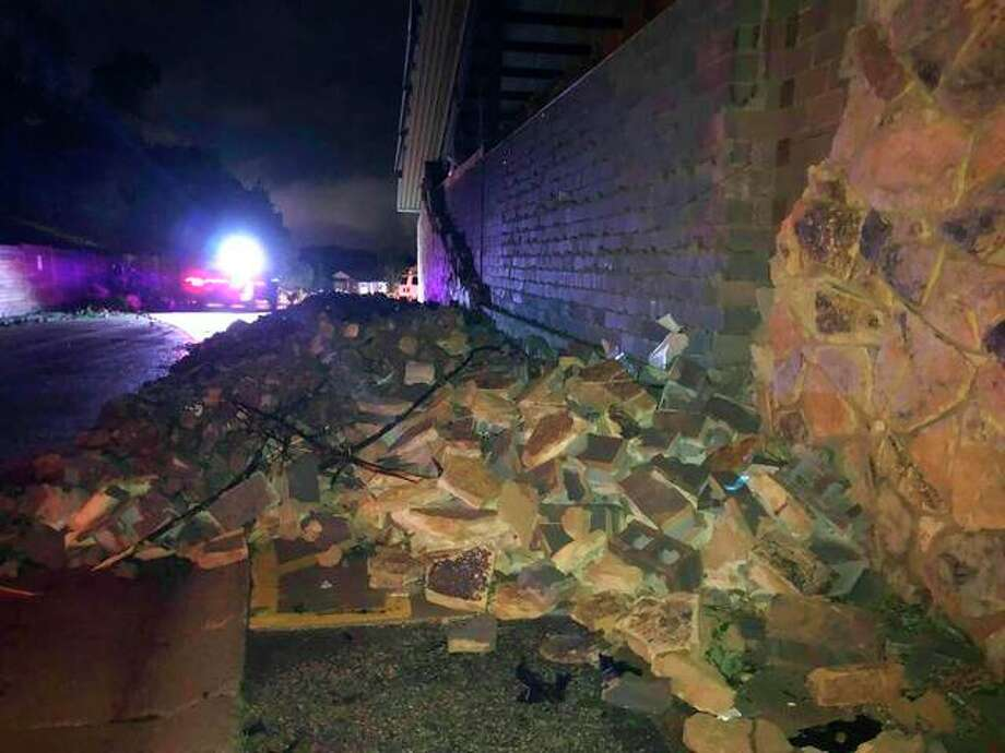 "A wall is collapsed in Jefferson City, Missouri on Thursday May 23, 2019. The U.S. National Weather Service says a ""violent tornado"" has touched down in Jefferson City, Missouri, causing possible fatalities and heavy damage. (AP Photo/David Lieb)"