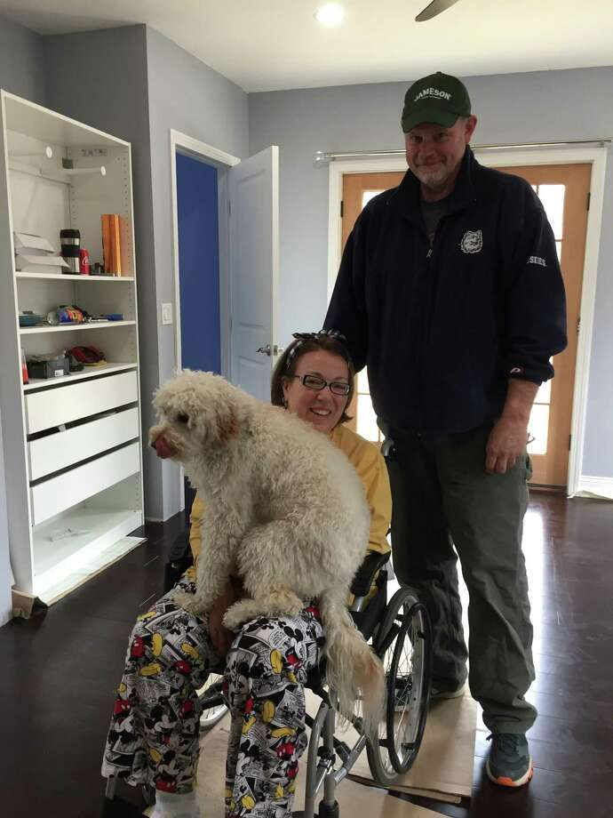 HARK ALS, plus friends and family of Newtown resident Laurena McCarthy, have announce an evening of comedy June 15 at Danbury's Palace Theatre to celebrate and support her as she faces advanced stage Amyotrophic Lateral Sclerosis (ALS). Pictured are Laurena and Bill McCarthy with their dog Penny. Photo: Liz Fancher / Contributed Photo