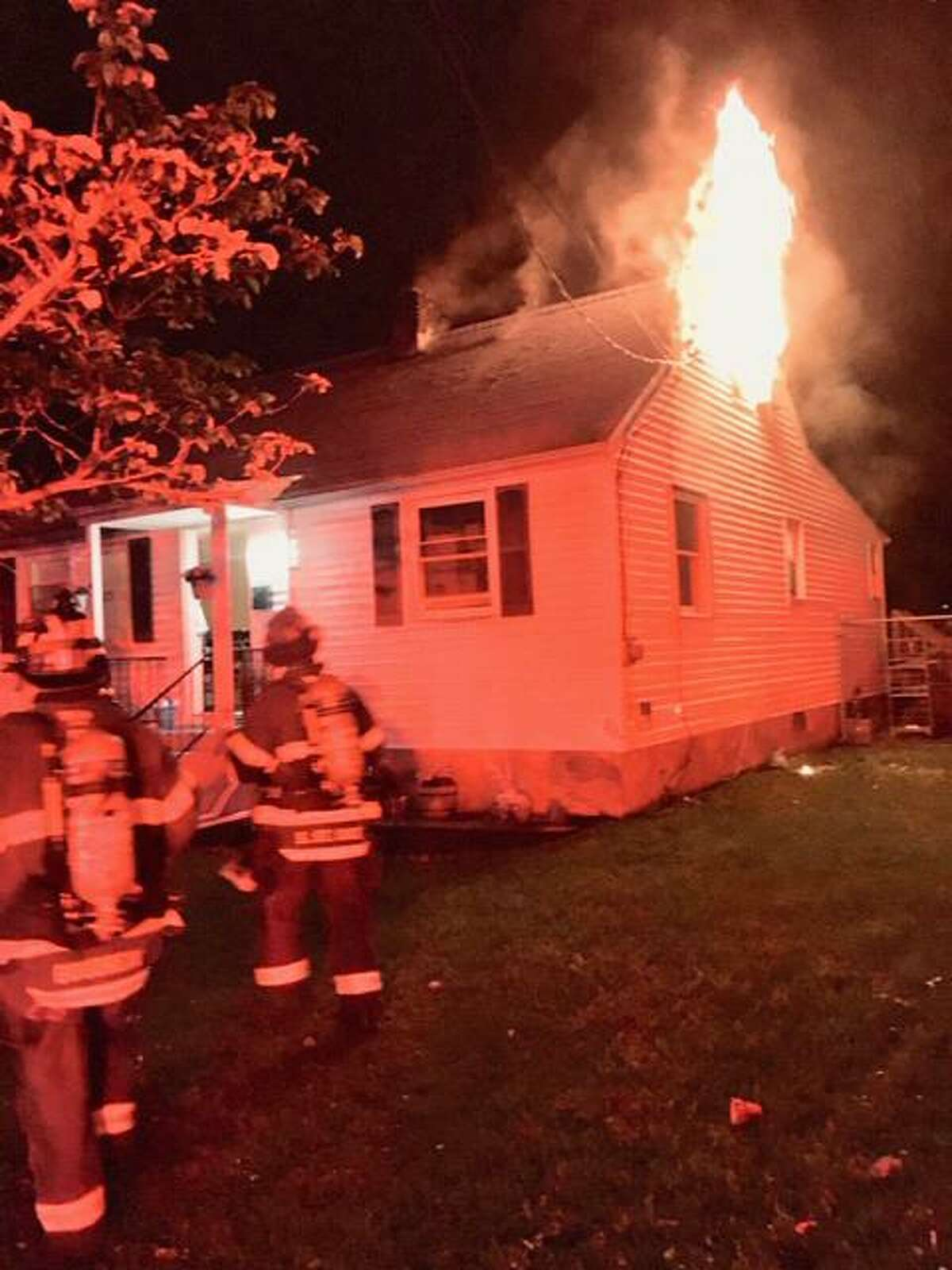 Three people escaped a house fire unharmed on Curtone Road late Wednesday.