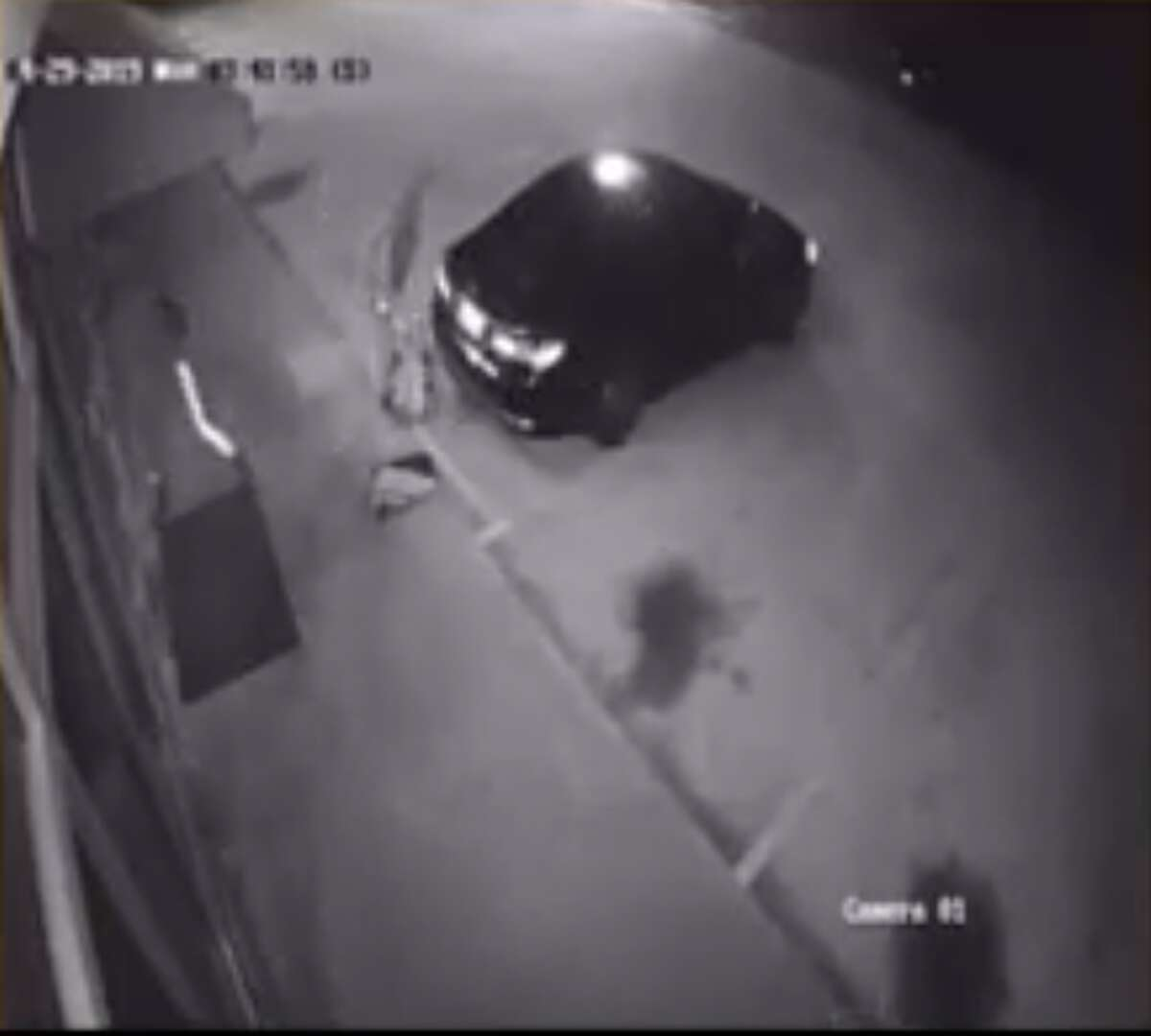 In the video, the suspects appear to break the glass front door and enter the business.