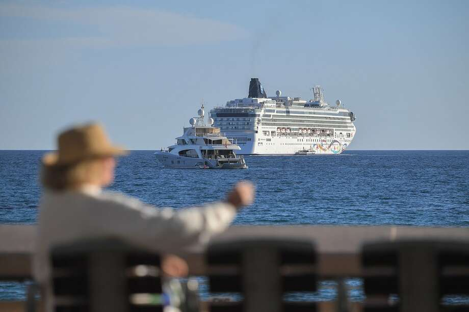 FILE — The dawn-class cruise ship Norwegian Star, operated by Norwegian Cruise Line (NCL), moors in the Bay of Cannes on May 13, 2019 on the eve of the opening of the 72nd edition of the Cannes Film Festival in Cannes, southern France.  Photo: Loic Venance, AFP/Getty Images