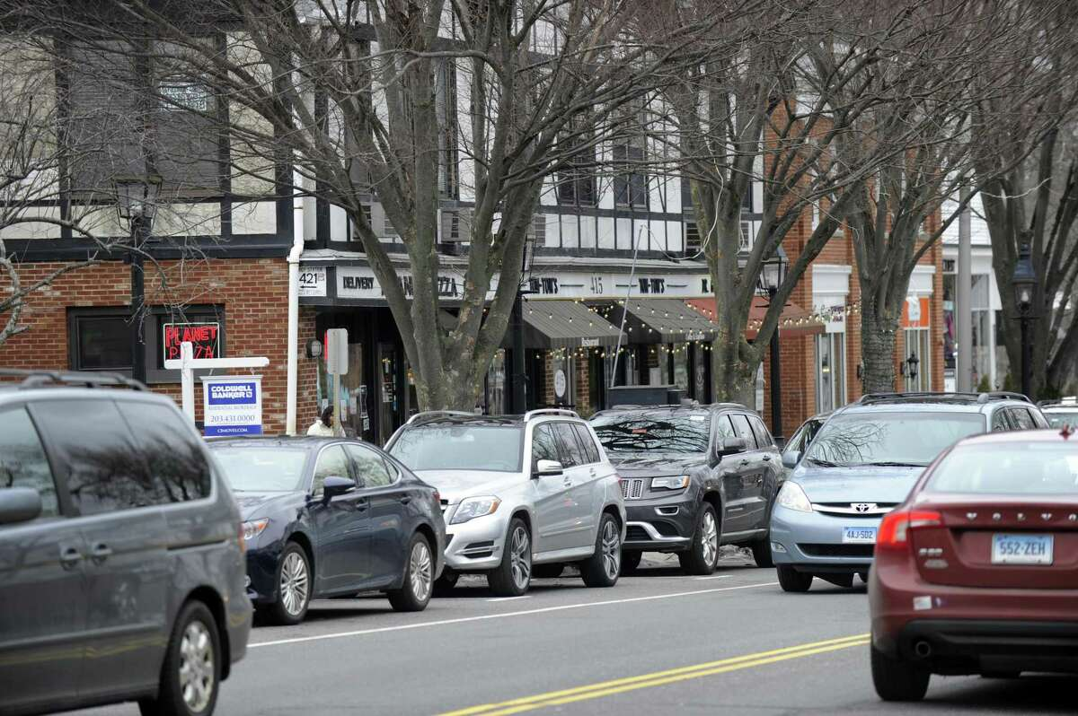 There is parking, for those that can find an open space, along Main Street in Ridgefield, Wednesday, February 17, 2016. Ridgefield residents said in a survey that they do not want a parking garage, but do feel that parking is a problem in downtown Ridgefield. Photo of Main Street, Ridgefield, Conn., Wednesday, February 17, 2016.