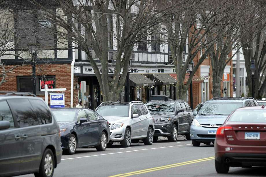 There is parking, for those that can find an open space, along Main Street in Ridgefield, Wednesday, February 17, 2016. Ridgefield residents said in a survey that they do not want a parking garage, but do feel that parking is a problem in downtown Ridgefield. Photo of Main Street, Ridgefield, Conn., Wednesday, February 17, 2016. Photo: Carol Kaliff / Hearst Connecticut Media / The News-Times