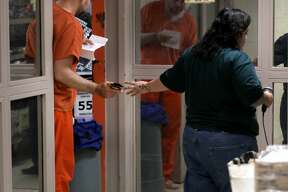 An inmate at the Bexar County Detention Center buys items at the commissary, on Thursday, May 9, 2019.