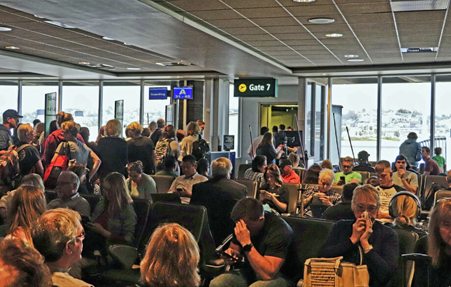 Expect to see plenty of airport crowds this summer as passenger numbers hit a record high for the peak season. Photo: Jim Glab