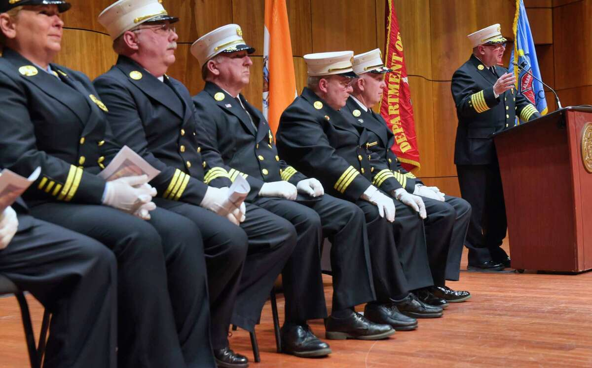 Albany Fire Chief Joseph Gregory, at podium, addresses those gathered for the Probationary Firefighters Class Graduation Ceremony at the Massry Center on the campus of The College of Saint Rose on Thursday, May 23, 2019, in Albany, N.Y. Probationary firefighters for Albany, Troy, and Rensselaer received certificates at the event. (Paul Buckowski/Times Union)