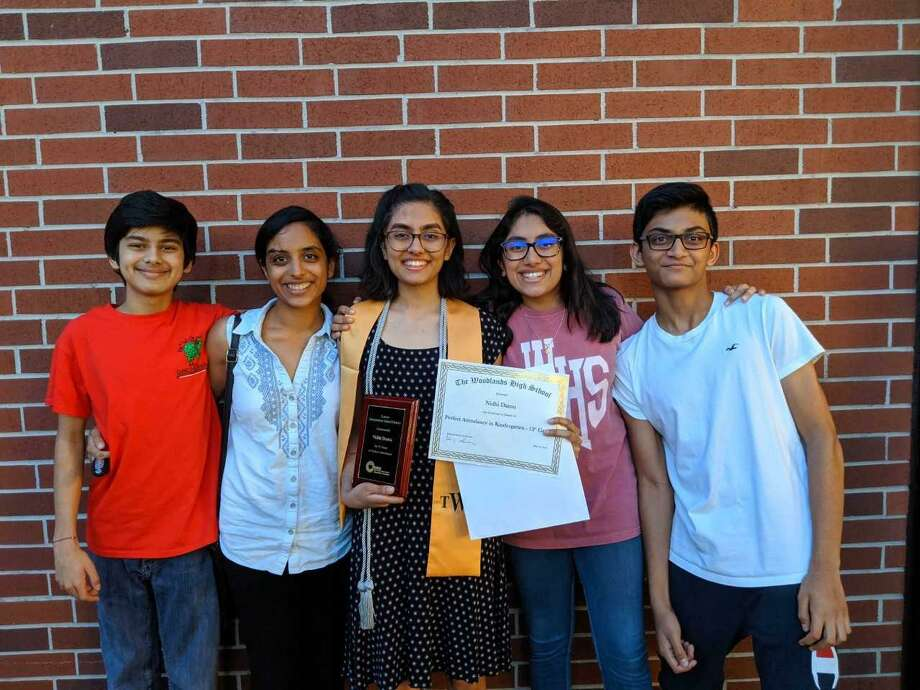 Nidhi Damu (center), a graduating senior at The Woodlands High School, stands with her (from left to right) brother Naman Damu, cousin Arpita Beechar, sister Shivani Damu and cousin Arjun Makken after a school awards night where she was recognized for having perfect attendance throughout her school career. Photo: Submitted Photo / Submitted Photo