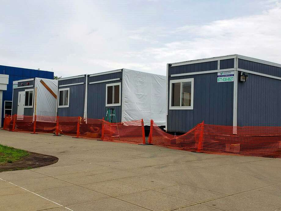 Four portable classrooms by Vanguard Modular Building Systems arrived this week at Bedford Middle School in preparation for the influx of Coleytown students this fall. Joseph Marcella, superintendent for the project, said two additional classrooms will arrive in the next 10 days, to be placed on the opposite end of the school. Photo: Liana Teixeira / Hearst Connecticut Media