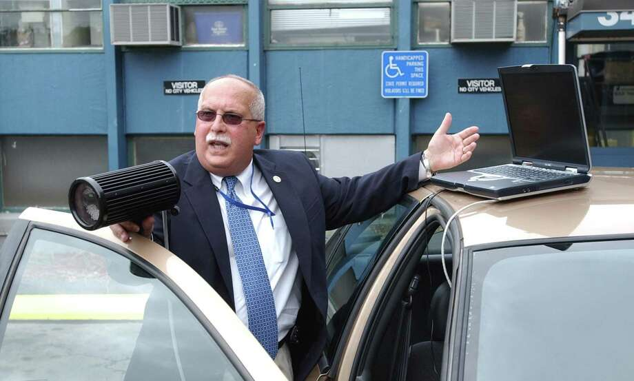 """New Haven Tax Collector C.J. Cuticello explains the workings of the city's new """"Boot Finder"""" licence plate reader system that will be used by the city to impound cars that belong to residents that are delinquent in property taxes. Photo: Hearst Connecticut Media File"""