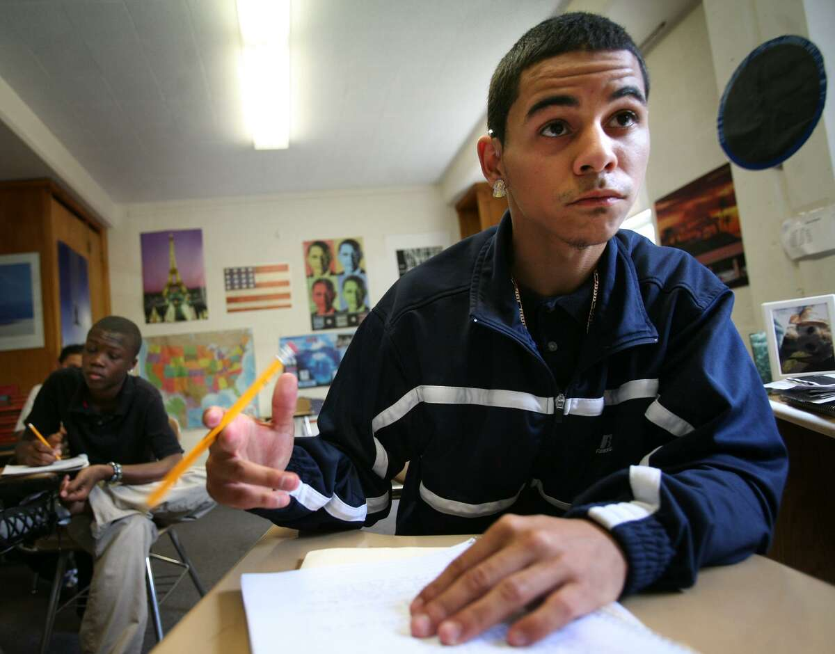 Junior Jockson Robledo, 18, copies notes from the board during class at the University School alternative education school in Bridgeport on Thursday, June 7, 2012. Robledo said he hopes the school won't close, because he doesn't want to return to his former school, Harding, where he got into lots of trouble.