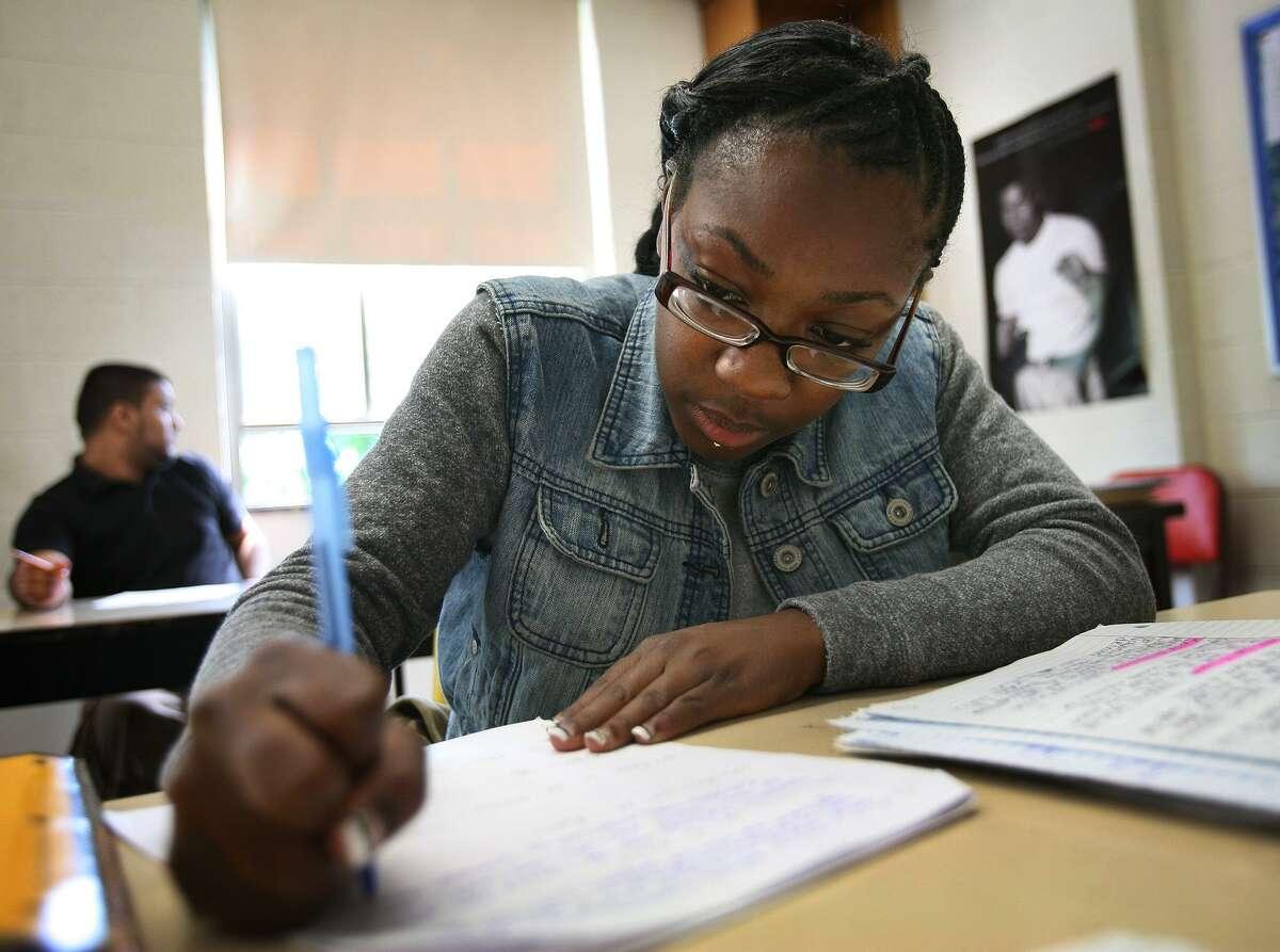 Senior Daisha Baldwin, 19, gets down to work at the University School alternative education school in Bridgeport on Thursday, June 7, 2012.