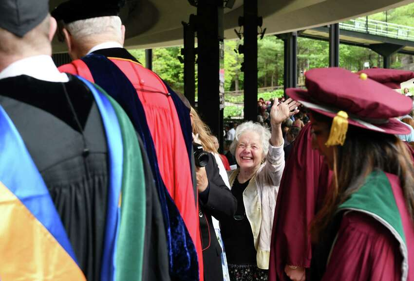 An attendee waves to the graduates as they proceed down the aisle during the Albany Medical College commencement ceremony on Thursday, May 23, 2019 at the Saratoga Performing Arts Center in Saratoga Springs, NY. (Phoebe Sheehan/Times Union)