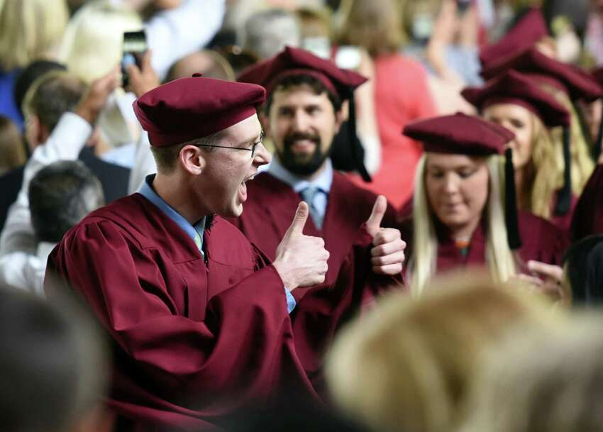 A graduate gives a 'thumbs up' signal to the crowd while proceeding down the aisle during the Albany Medical College commencement ceremony on Thursday, May 23, 2019 at the Saratoga Performing Arts Center in Saratoga Springs, NY. (Phoebe Sheehan/Times Union)