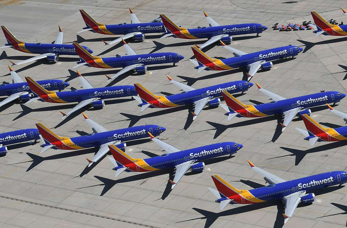 In this file photo taken on March 28, 2019 Southwest Airlines Boeing 737 MAX aircraft are parked on the tarmac after being grounded, at the Southern California Logistics Airport in Victorville, California. -