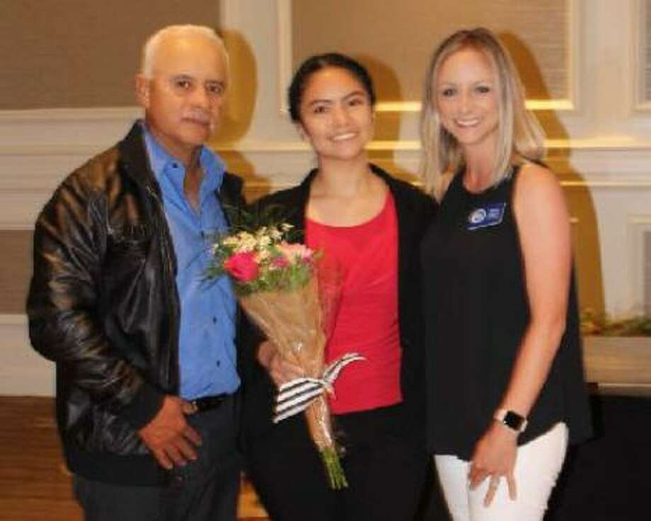 Jazmine Perez, 2019 Volunteer Scholarship Recipient, with her father,Jesus Perez, and Fort Bend Junior Service League President Emily Calbert. Photo: Fort Bend Junior Service League / Fort Bend Junior Service League