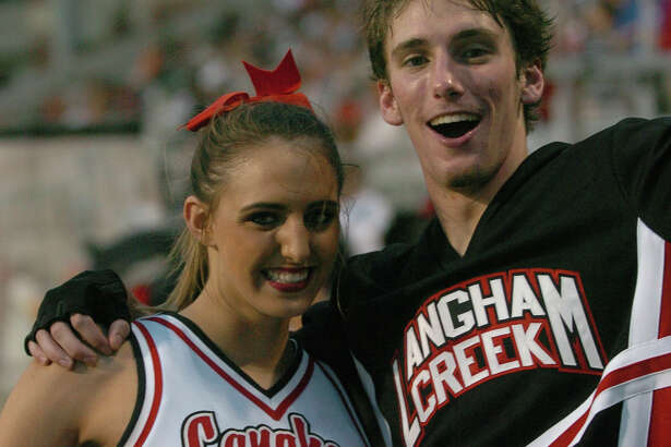 Langham Creek's cheerleaders, left, Jessie Chapman, junior, and Cameron Ayala, senior, at Langham Creek's football game against Katy Taylor on Sept. 1, 2006 at Cy-Fair ISD's Berry Center. Langham Creek won the game 21-14 in the first game ever played at the Berry Center.