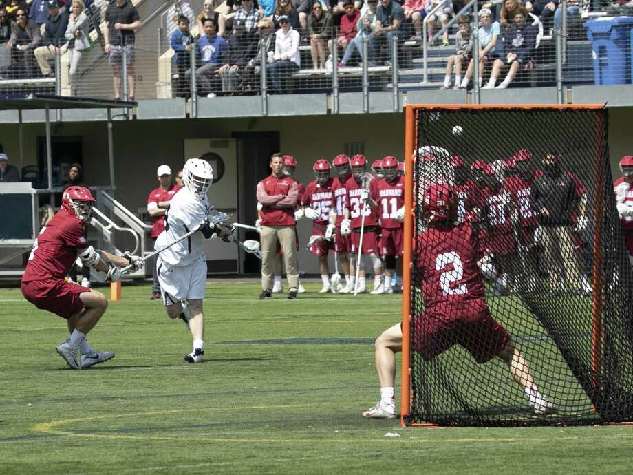 Yale's Jack Tigh winds up for a shot against Harvard earlier this season. Photo: Yale University Athletics / ©2018 Steve Musco , All rights reserved