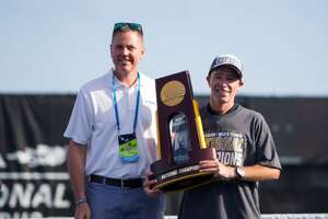 ORLANDO, FL - MAY 19: University of Texas Interim Head Tennis Coach Bruce Berque poses with the championship trophy after winning the NCAA Division I National Tennis Championships on May 19, 2019, at the USTA National Campus in Orlando, FL. (Photo by Mary Holt/Icon Sportswire via Getty Images)