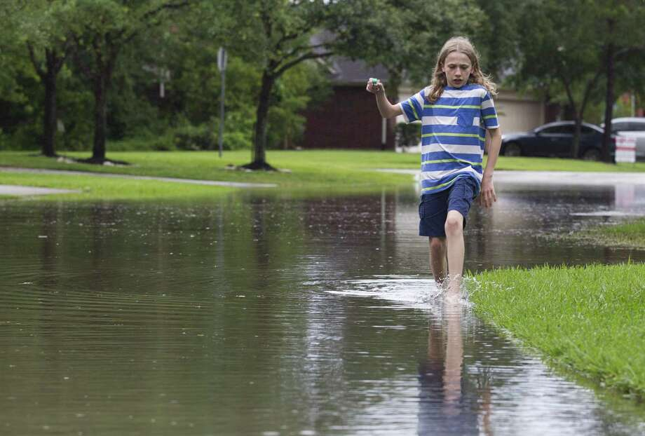 Lane Fisher explores a flooded street near his house in Kingwood as heavy rains soak Greater Houston, Friday, May 3, 2019. Photo: Jason Fochtman, Houston Chronicle / Staff Photographer / © 2019 Houston Chronicle