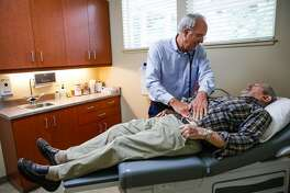 Walter Pierce (right), 83, of Magalia, gets a physical examination from Dr. Richard Turner at the Paradise Medical Group in Paradise, California, on Thursday, May 23, 2019. Paradise Medical Group, the largest independent medical provider in Paradise, is reopening its primary care center this week after being closed due to the Camp Fire.