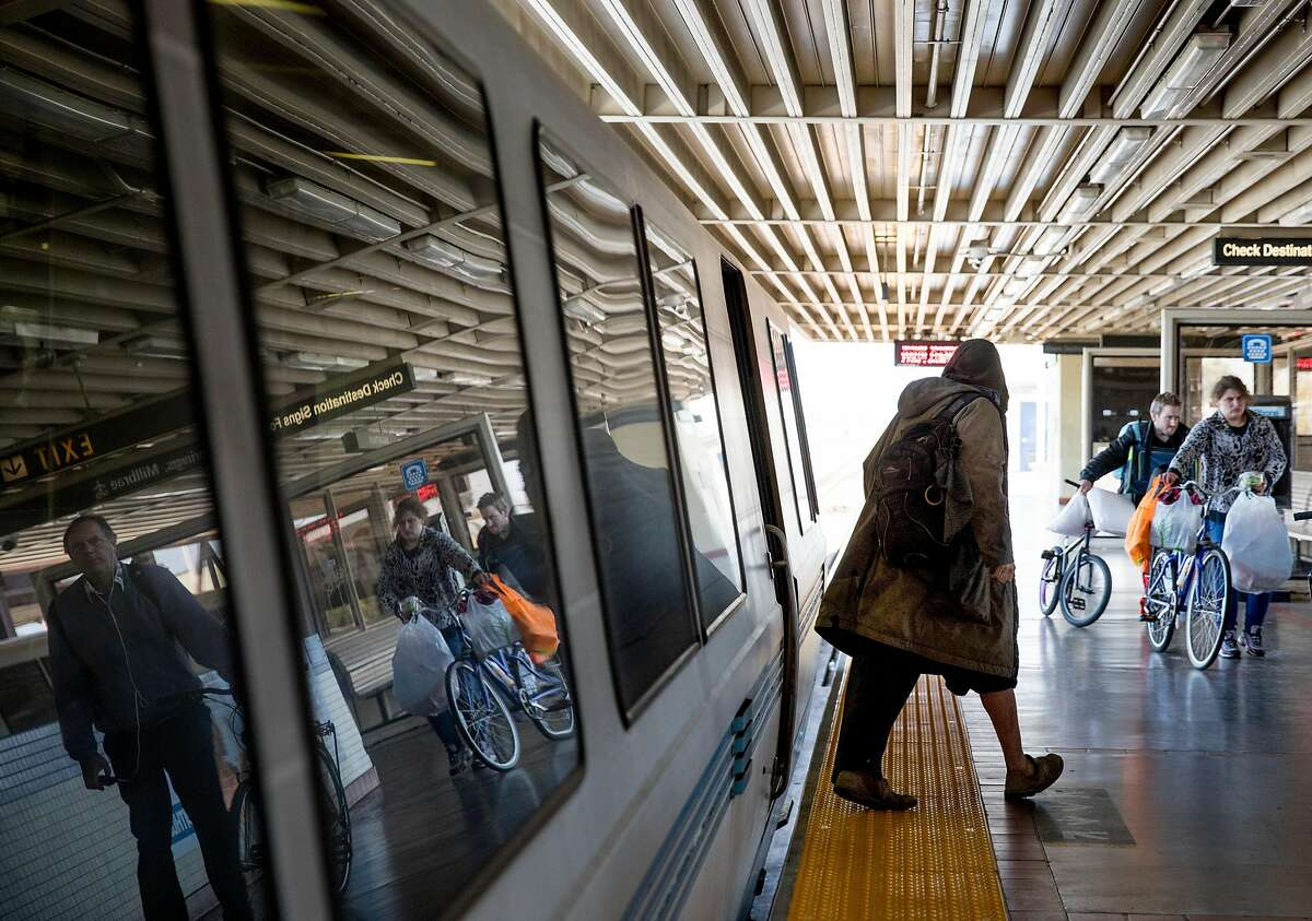 A homeless man exits a train at MacArthur BART Station in Oakland, Calif. Thursday, May 23, 2019.