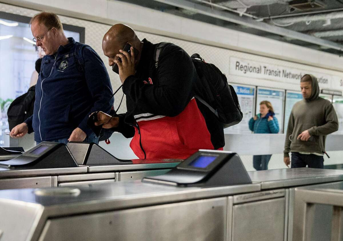 A rider uses his ticket to enter the platform area of the Powell BART Station in San Francisco, Calif. Thursday, May 23, 2019.