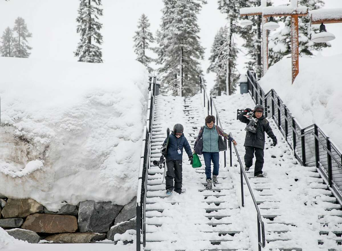A group descends the staircase near a heavy snow pack before enjoying the slopes during a moderate snowfall at Sierra-at-Tahoe Resort in Twin Bridges, Calif. Tuesday, April 2, 2019.