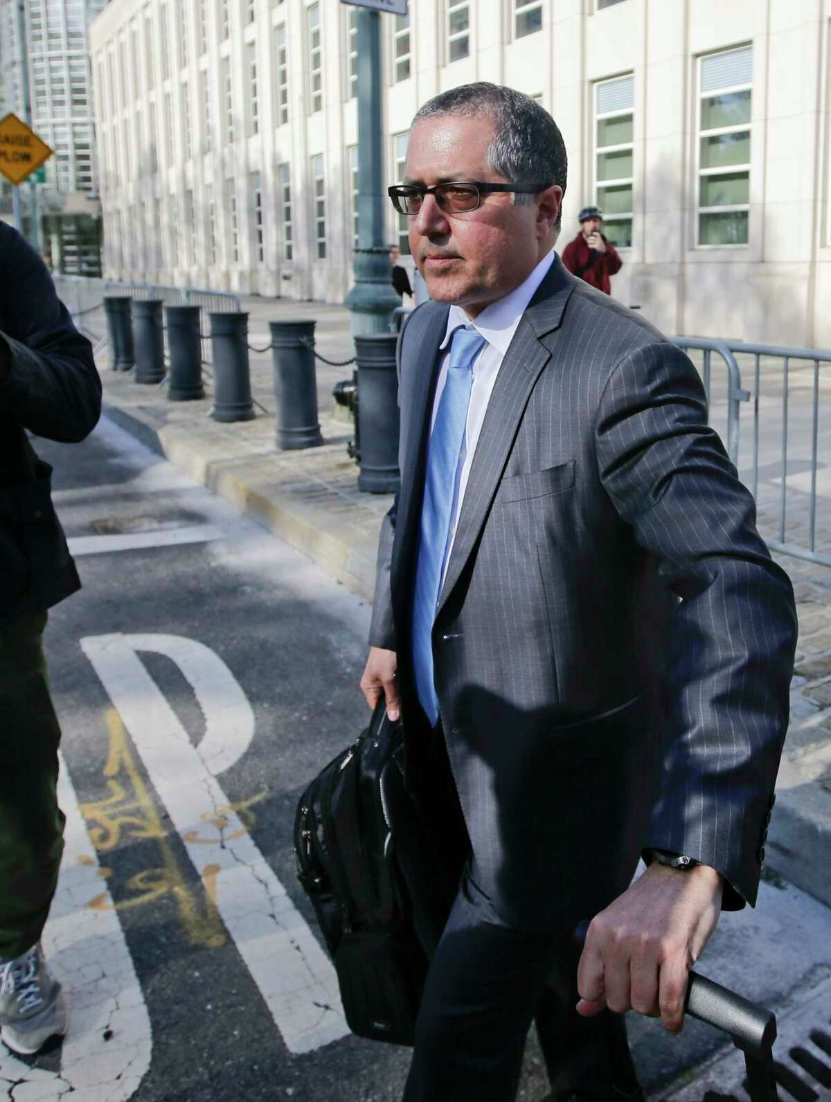 Marc Agnifilo, attorney for Keith Raniere, leaves Brooklyn federal court Tuesday, May 7, 2019, in New York. Raniere, the former leader of the self help group called NXIVM, has pleaded not guilty to the charges that he turned his followers into sex slaves.
