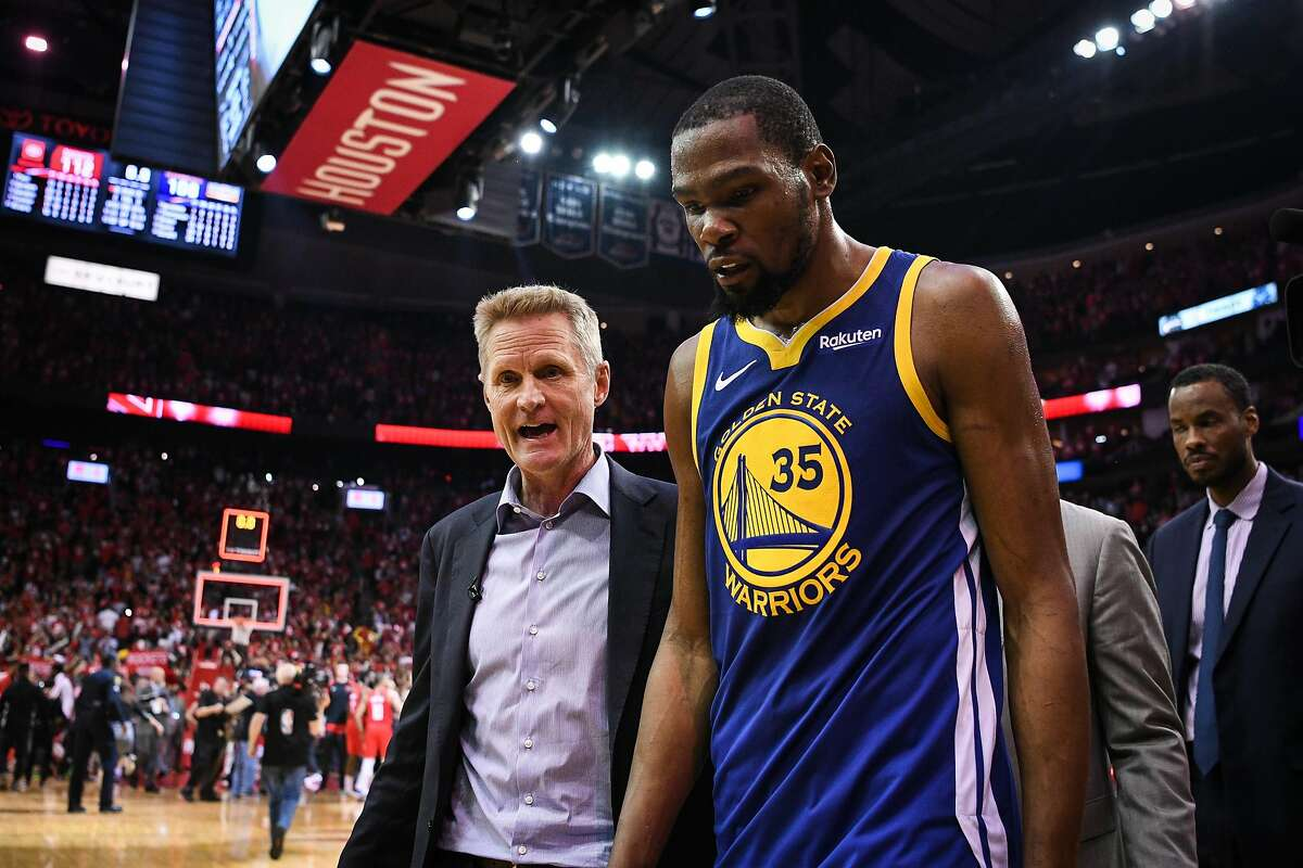 Golden State Warriors head coach Steve Kerr and forward Kevin Durant (35) walk off the court following a loss in game 4 of the NBA Western Conference Semifinals between the Golden State Warriors and Houston Rockets at the Toyota Center in Houston, Texas, on Monday, May 6, 2019.