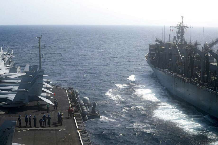 The Nimitz-class aircraft carrier USS Abraham Lincoln (CVN 72) pulling alongside the fast combat support ship USNS Arctic (T-AOE 8) during a replenishment-at-sea Sunday. The saber rattling with Iran has its purpose because sanctions alone won't result in regime change in Iran. Photo: MC3 DARION CHANELLE TRIPLETT /AFP /Getty Images / AFP