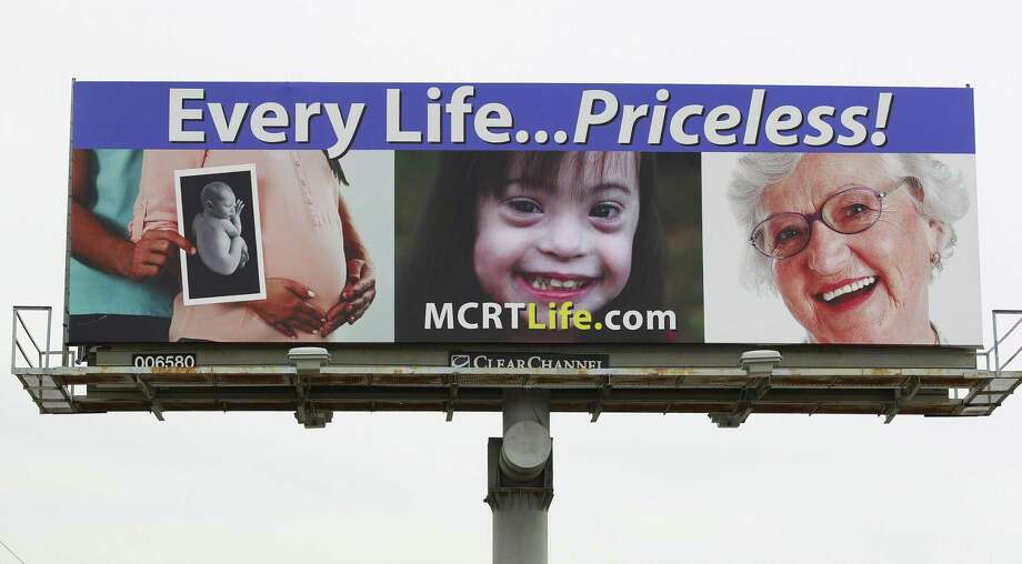 "The billboard wars. A pro-life billboard from Montgomery County Right to Life is seen on Texas 105 headed east Feb. 2, 2017, in Conroe. In Colorado, a billboard heralds the state as where you can get a ""safe, legal abortion."" Photo: Jason Fochtman /Houston Chronicle / © 2017 Houston Chronicle"