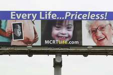 """The billboard wars. A pro-life billboard from Montgomery County Right to Life is seen on Texas 105 headed east Feb. 2, 2017, in Conroe. In Colorado, a billboard heralds the state as where you can get a """"safe, legal abortion."""""""
