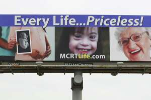 "The billboard wars. A pro-life billboard from Montgomery County Right to Life is seen on Texas 105 headed east Feb. 2, 2017, in Conroe. In Colorado, a billboard heralds the state as where you can get a ""safe, legal abortion."""