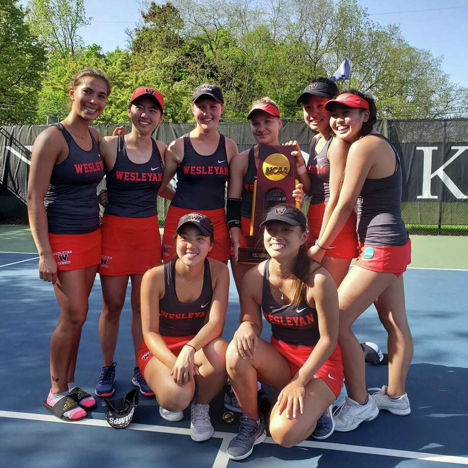 Members or the national champion Wesleyan tennis team pose for a photo after their win. Photo: Wesleyan University Athletics