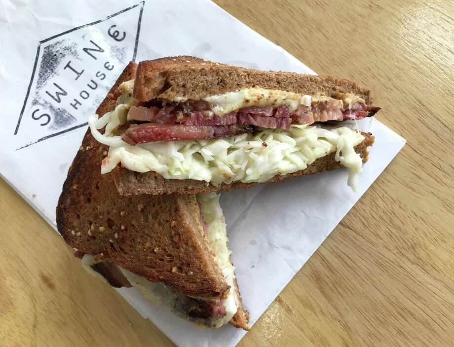 A pastrami, sauerkraut and cheese sandwich from Swine House Bodega, which is located at 124 N. Main Ave. in downtown San Antonio. Photo: Paul Stephen / Staff