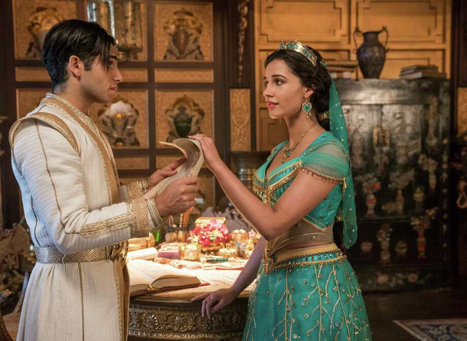 "This image released by Disney shows Mena Massoud as Aladdin, left, and Naomi Scott as Jasmine in Disney's live-action adaptation of the 1992 animated classic ""Aladdin."" (Daniel Smith/Disney via AP) Photo: Daniel Smith / (c) 2019 Disney Enterprises Inc. All Rights Reserved."
