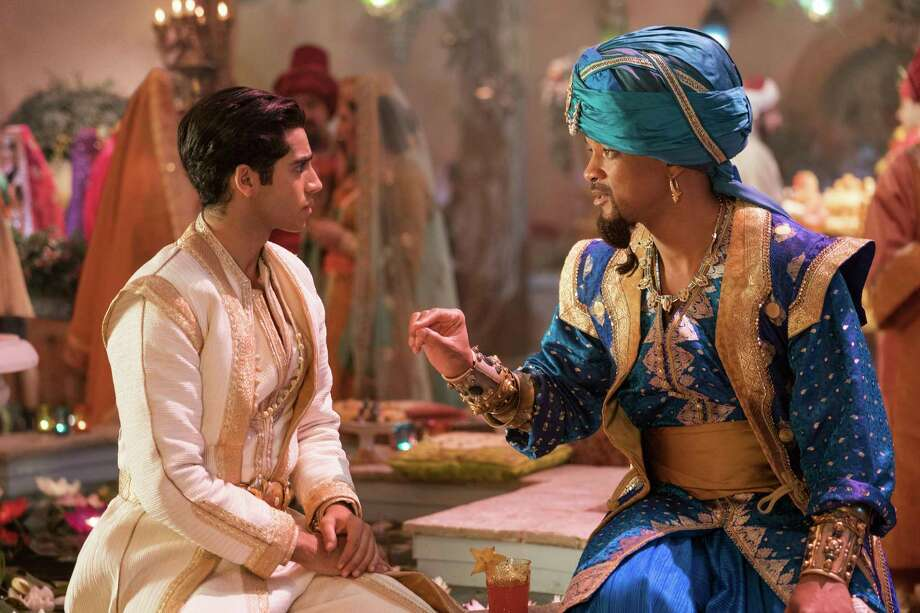 "This image released by Disney shows Mena Massoud as Aladdin, left, and Will Smith as Genie in Disney's live-action adaptation of the 1992 animated classic ""Aladdin."" (Daniel Smith/Disney via AP) Photo: Daniel Smith / (c) 2019 Disney Enterprises Inc. All Rights Reserved."