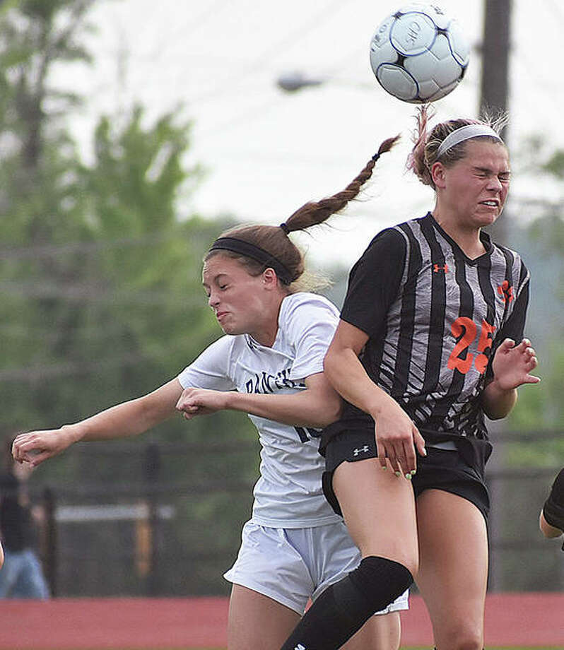 Edwardsville's Hannah Bielicke, right, goes up for a header during Tuesday's semifinal game against O'Fallon in the Class 3A Moline Sectional at Collinsville High School. Photo: Matt Kamp | For The Telegraph