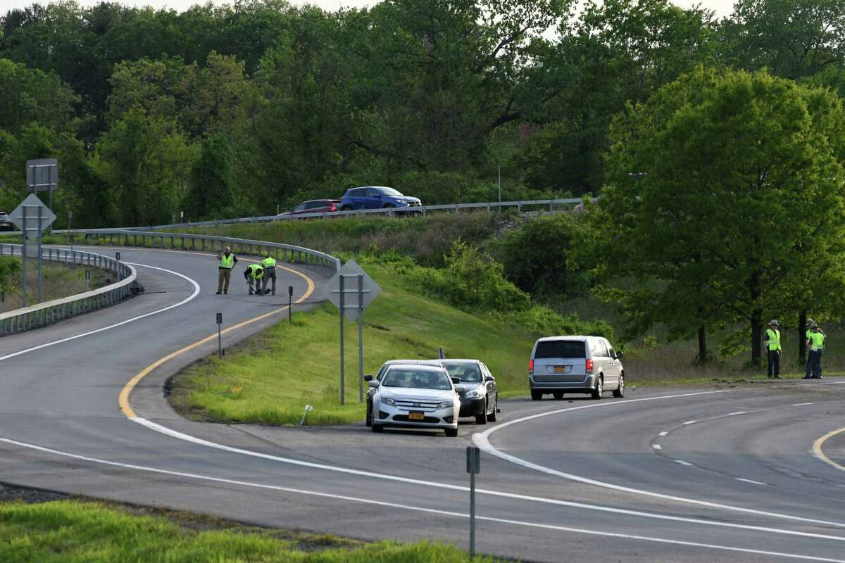 Investigators survey the scene of a fatal crash on the I-87 to I-90 east offramp on Thursday, May 23, 2019, in Albany, N.Y. . (Will Waldron/Times Union)