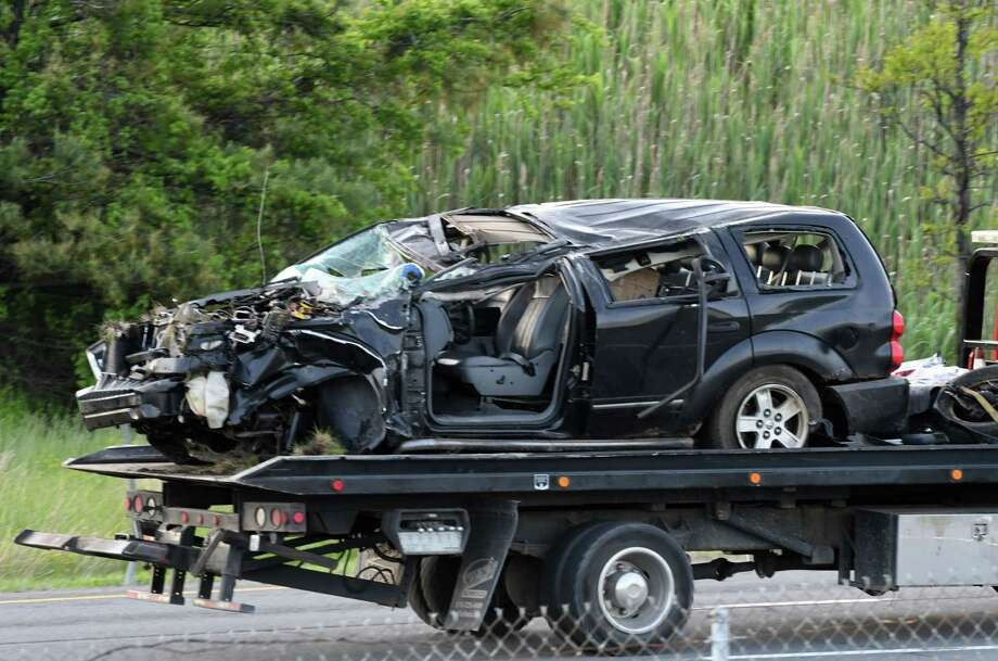 The vehicle involved in a fatal crash on the I-87 offramp to I-90 east is towed away on Thursday, May 23, 2019, in Albany, N.Y. . (Will Waldron/Times Union) Photo: Will Waldron, Albany Times Union