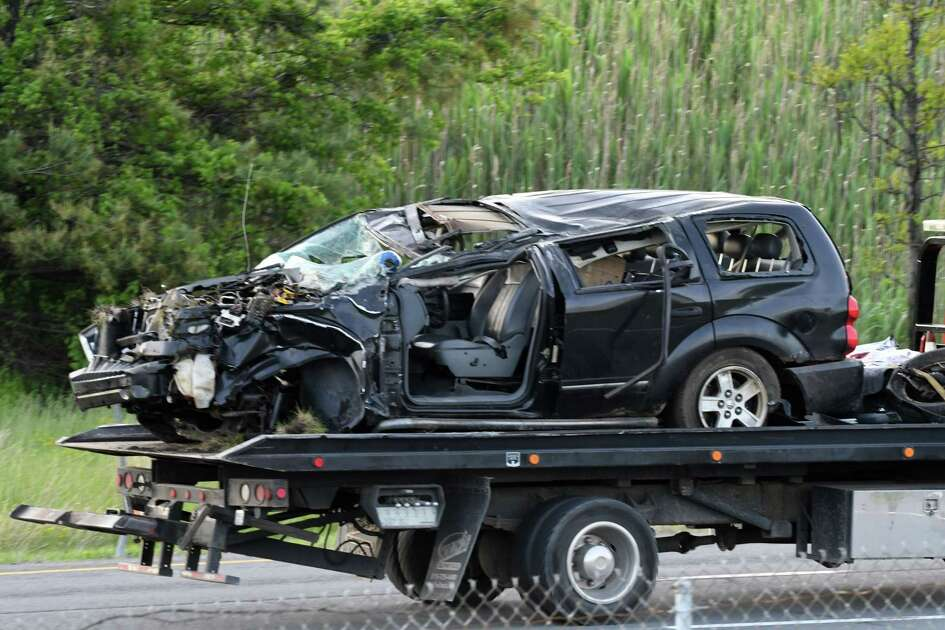 The vehicle involved in a fatal crash on the I-87 offramp to I-90 east is towed away on Thursday, May 23, 2019, in Albany, N.Y. . (Will Waldron/Times Union)