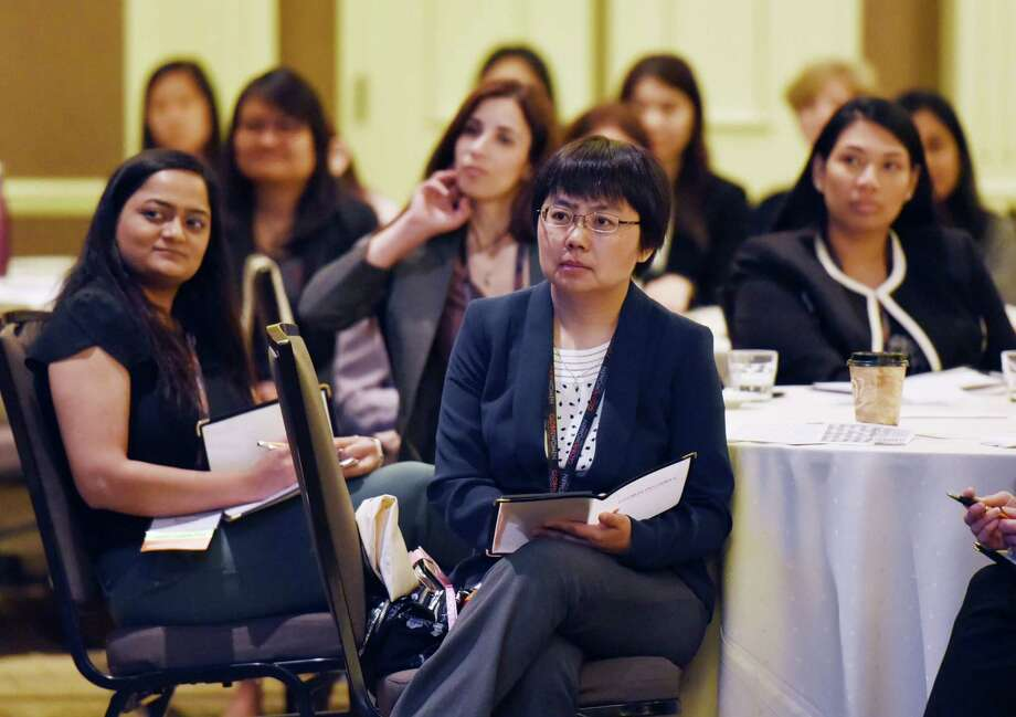 Attendees listen to key note speaker Nora Denzel during the first Saratoga International Global Women Conference on Thursday, May 23, 2019 at the Saratoga Hilton in Saratoga Springs, NY. (Phoebe Sheehan/Times Union) Photo: Phoebe Sheehan / 20047021A
