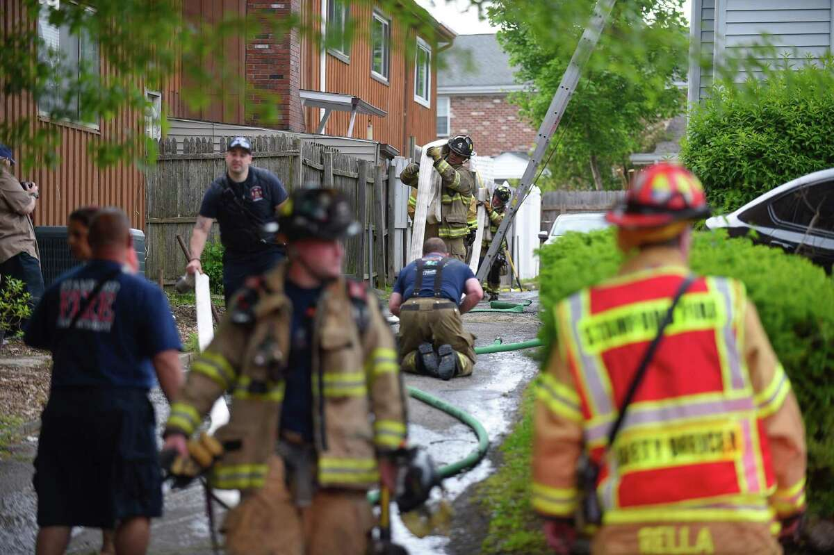 Stamford firefighters respond to a two-story house on Fairfield Avenue on Thursday, May 23, 2019.
