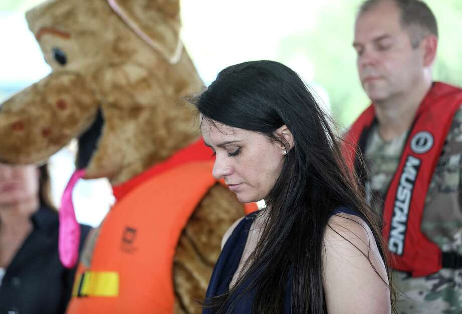 "Jenny Bennett, whose 18-month-old son Jackson drowned, pauses to compose herself during a press conference about summer water safety at Alexander Deussen Park on Thursday, May 23, 2019, in Houston. Bennett, who said she was an emergency room nurse, performed CPR on her son after pulling him from the water. ""I was hopeful because it had only been a few minutes, because his skin was still warm,"" she said. ""We tried everything we could to keep him safe, but we just didn't know about drowning."" Photo: Jon Shapley, Houston Chronicle / Staff Photographer / © 2019 Houston Chronicle"