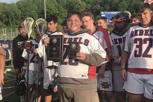 The New Fairfield boys lacrosse team won its third straight SWC title Thursday behind a 14-2 win over Weston.