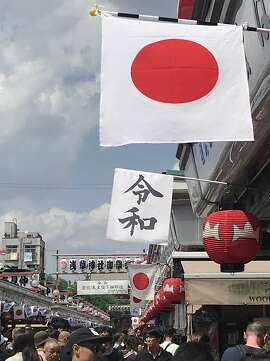 Crowds at the Sensoji Temple grounds in Tokyo, on Golden Week, May 4 2019. The Japanese characters spell Reiwa, the name of the new era in Japanese. Carl Nolte/the Chronicle