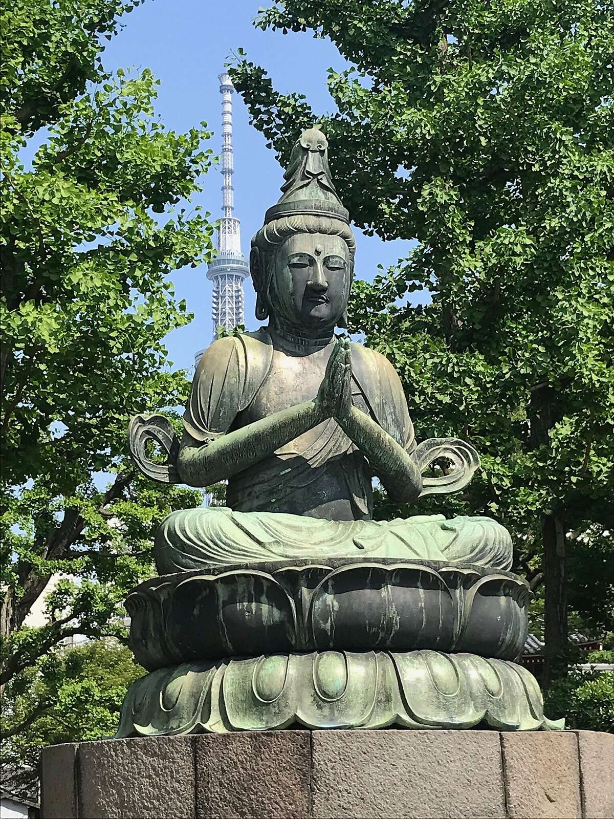 Ancient statue of the Buddha at the Sensoji temple grounds, Tokyo, may 4, 1019. The modern tower behind is a landmark in the Asakusa District of Tokyo. Carl Nolte/the Chronicle