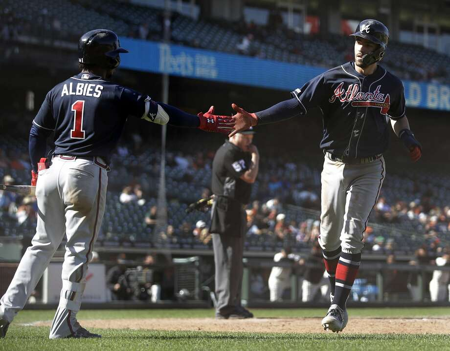 Atlanta Braves' Dansby Swanson, right, is congratulated by Ozzie Albies (1) after scoring against the San Francisco Giants during the 13th inning inning of a baseball game Thursday, May 23, 2019, in San Francisco. Swanson scored on a single by Austin Riley. (AP Photo/Ben Margot) Photo: Ben Margot / Associated Press