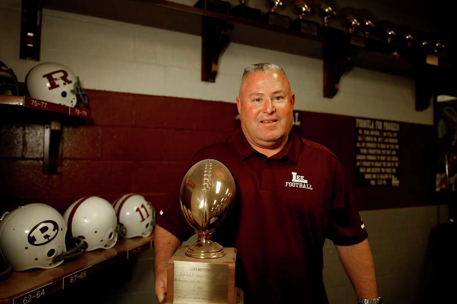 Lee High School boys soccer coach and assistant football coach Scott Hicks is retiring after a long career. Photographed May 23, 2019,  Hicks holds a trophy from 1983 when he was a member of the Lee football team that beat Odessa Permian in a quarterfinal match. James Durbin/Reporter-Telegram Photo: James Durbin / Midland Reporter- / © 2019 All Rights Reserved